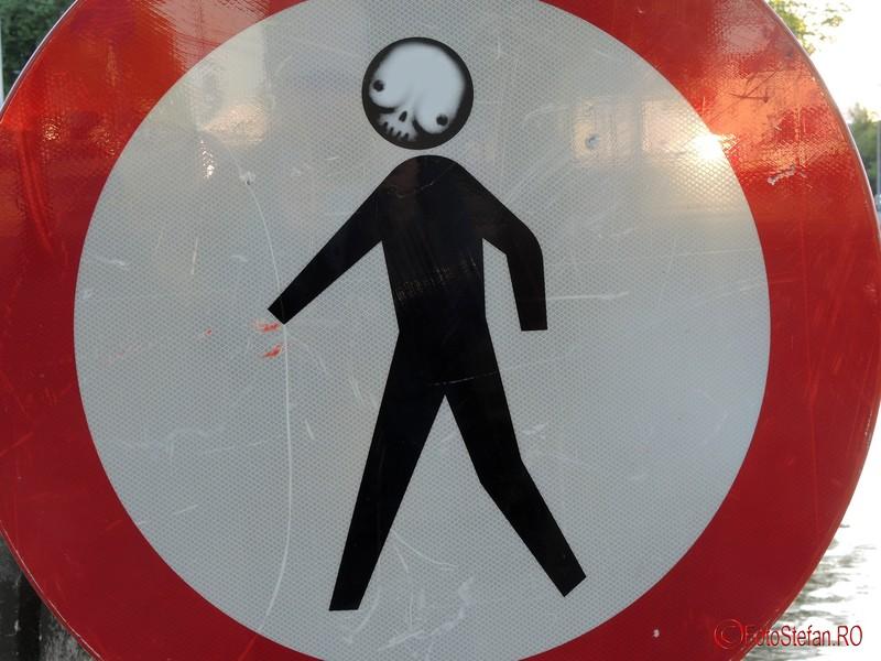 poza street art amsterdam olanda