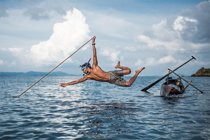 poza pescar moken pescuind premiu nikon