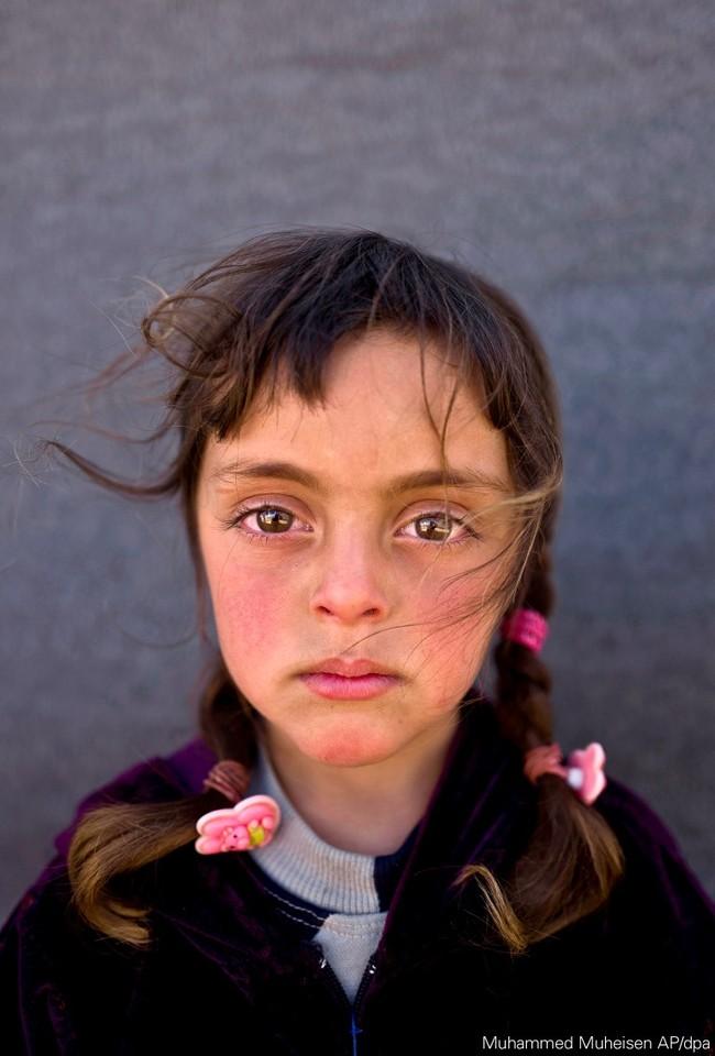 fotografie portret fata fetita refugiat emigrant poza anului unicef