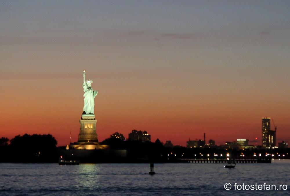 poza statuia libertatii apus calatorie america cardul revolut