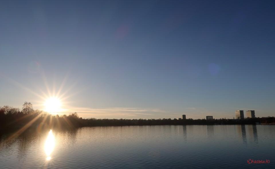 fotografie raze soara parc herastrau lac poza
